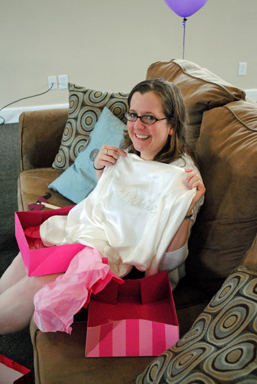 Allison opening gifts
