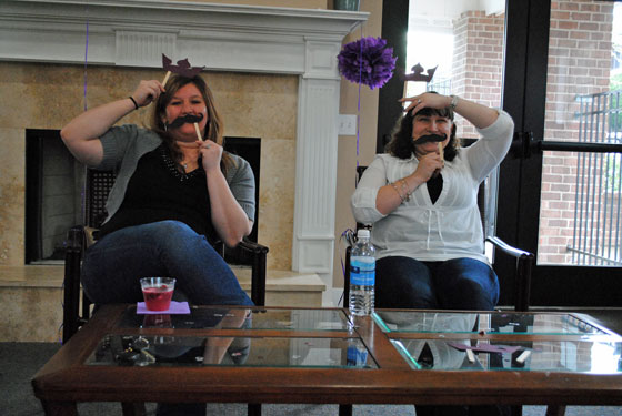 Stacy & Kelly playing Staches & Tiaras