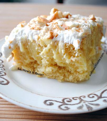 Banana Pudding Poke Cake Slice by So, How's It Taste