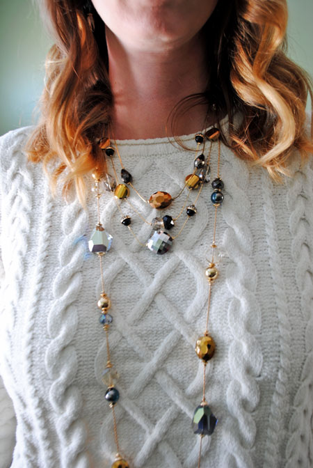 Sweater with layered necklaces
